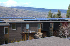 Solar panels on condominiums. Royalty Free Stock Photos