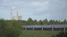 Solar Panels and Conventional Power Plant stock footage