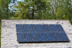 Solar panels on country roof. Solar panels fitted to slate roof on country cottage Royalty Free Stock Photos