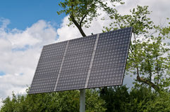 Solar panels in countryside. With cloudscape background Stock Image