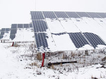 Solar panels covered with snow Stock Photography