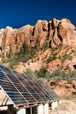 Solar panels in the desert. Reflecting the mountains Stock Photography