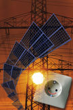 Solar panels, electric socket and power poles Royalty Free Stock Photo