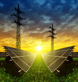Solar panels with electricity pylon Royalty Free Stock Photo