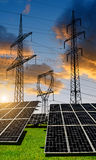 Solar panels with electricity pylons Royalty Free Stock Image