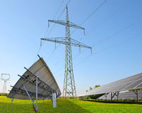 Solar panels with electricity pylons. Royalty Free Stock Image