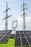 Solar panels with electricity pylons. Stock Photo
