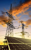 Solar panels with electricity pylons Stock Photo