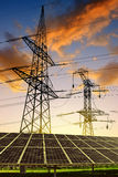 Solar panels with electricity pylons Stock Image