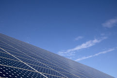Solar panels for energy saving with blue sky behind Royalty Free Stock Photos