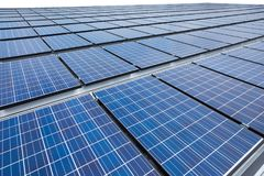 Solar panels on factory roof stock photos