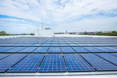 Solar panels on factory roof.  Stock Images