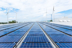 Solar panels on factory roof.  Stock Photography