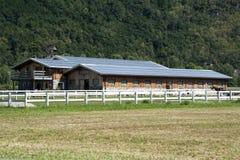 Solar panels farm. A modern farm with solar panels on the roof Stock Photo