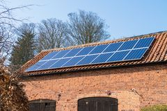 Solar panels on a farm building Stock Photo