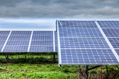 Solar Panels. At Solar Farm Derbyshire England cloudy sky Royalty Free Stock Images