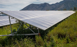 Solar Panels on Farmland - Renewable Energy. Solar panel array on farmland, providing green, clean, renewable energy. Crete, Greece Stock Image