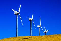 Four Windmills on a Hill Stock Photos