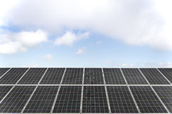 Solar panels. Field with many solar panels in front of a blue sky Royalty Free Stock Image
