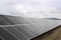 Solar panels. Field with many solar panels in front of a blue sky Stock Photos