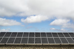 Solar panels. Field with many solar panels in front of a blue sky Stock Photo