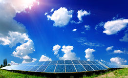 Solar panels on the field. Solar panels with the sunny sky Royalty Free Stock Photography