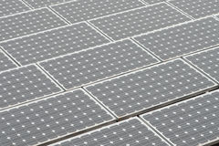 Solar panels on a flat rooftop Stock Images