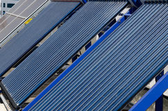 Solar panels. A fleet of solar panels on a building made stock image