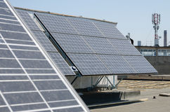 Solar panels. A fleet of solar panels on a building made stock photography