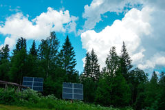 Solar panels in the forest. In the mountains Stock Images