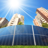 Solar Panels in Front of Apartment Buildings Royalty Free Stock Image