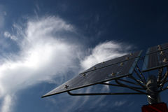 Solar panels in front of cirrus clouds. Solar panels in front of bizarre cirrus clouds stock photography