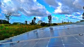 Solar Panel Power. Solar Panels functioning optimally in the tropical forest volcano lands, captured on a rooftop in Pahoa, Hawaii on Big Island in August 2017 Royalty Free Stock Photos