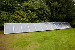 Solar panels in garden Royalty Free Stock Image