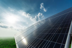 Solar panels generate power energy on blue sky at daytime Stock Photos