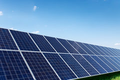 Solar panels generate power energy on blue sky at daytime Stock Photography