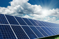 Solar panels generate power energy on blue sky at daytime Royalty Free Stock Image