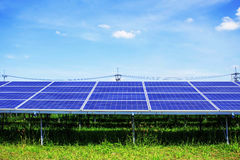 Solar panels on grass with sky. Royalty Free Stock Photos