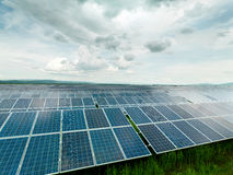 Solar panels on green field Stock Photo