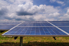Solar panels in green field Royalty Free Stock Photo