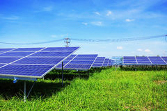 Solar panels on green grass. Solar panels on green grass with blue sky Stock Photo