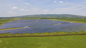 Solar panels on green grass with blue sky stock footage