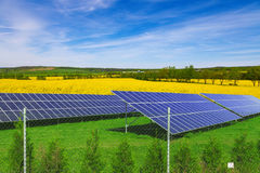 Solar panels on green grass, blue sky Stock Photography