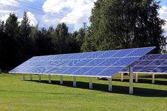 Solar Panels on Green Grass Field Royalty Free Stock Photography