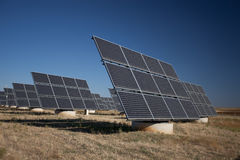 Solar panels in a greenfield Royalty Free Stock Image