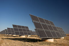 Solar panels in a greenfield Stock Images