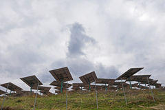 Solar panels on a grey and cloudy day. Some solar panels on a grey and cloudy day Stock Images