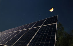Solar panels with the half moon Royalty Free Stock Image
