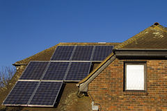 Solar panels on home. Domestic solar panels catching the sun's rays to power the home Royalty Free Stock Photo