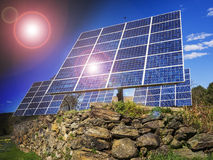 Solar panels for home. Solar panels in front of residential house with sun flare Royalty Free Stock Images